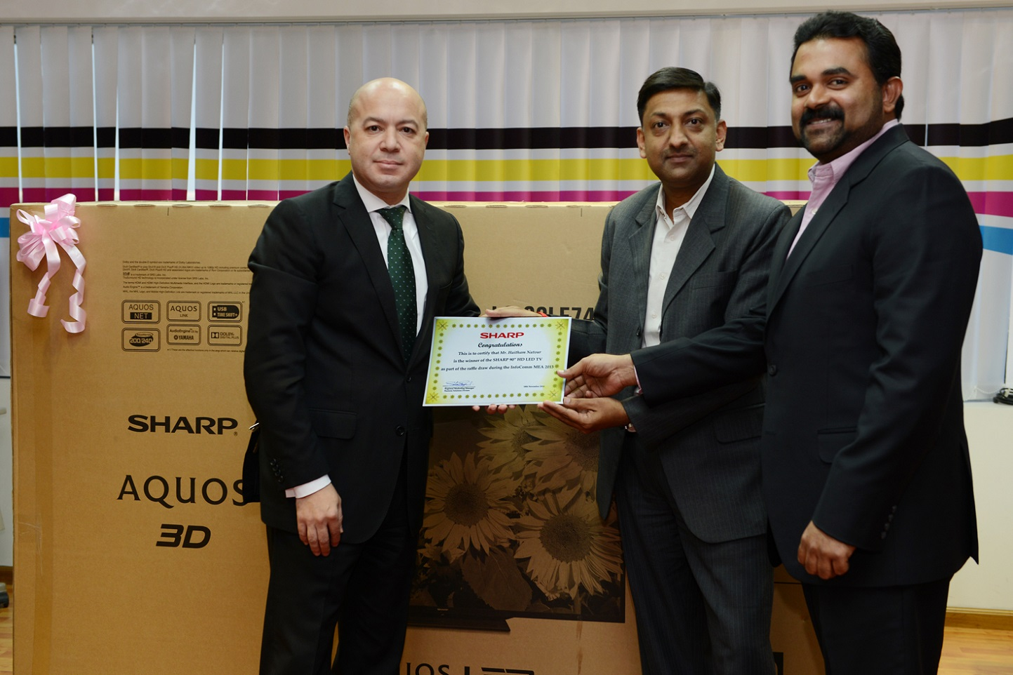 Mr. Natour receiving his prize and certificate from Mr. Rao and Mr. Samuel at the Sharp office